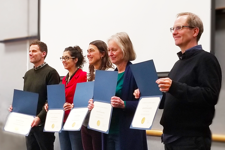 Fellows from the Creative Discovery Project display their recently presented certificates of completion at ceremony